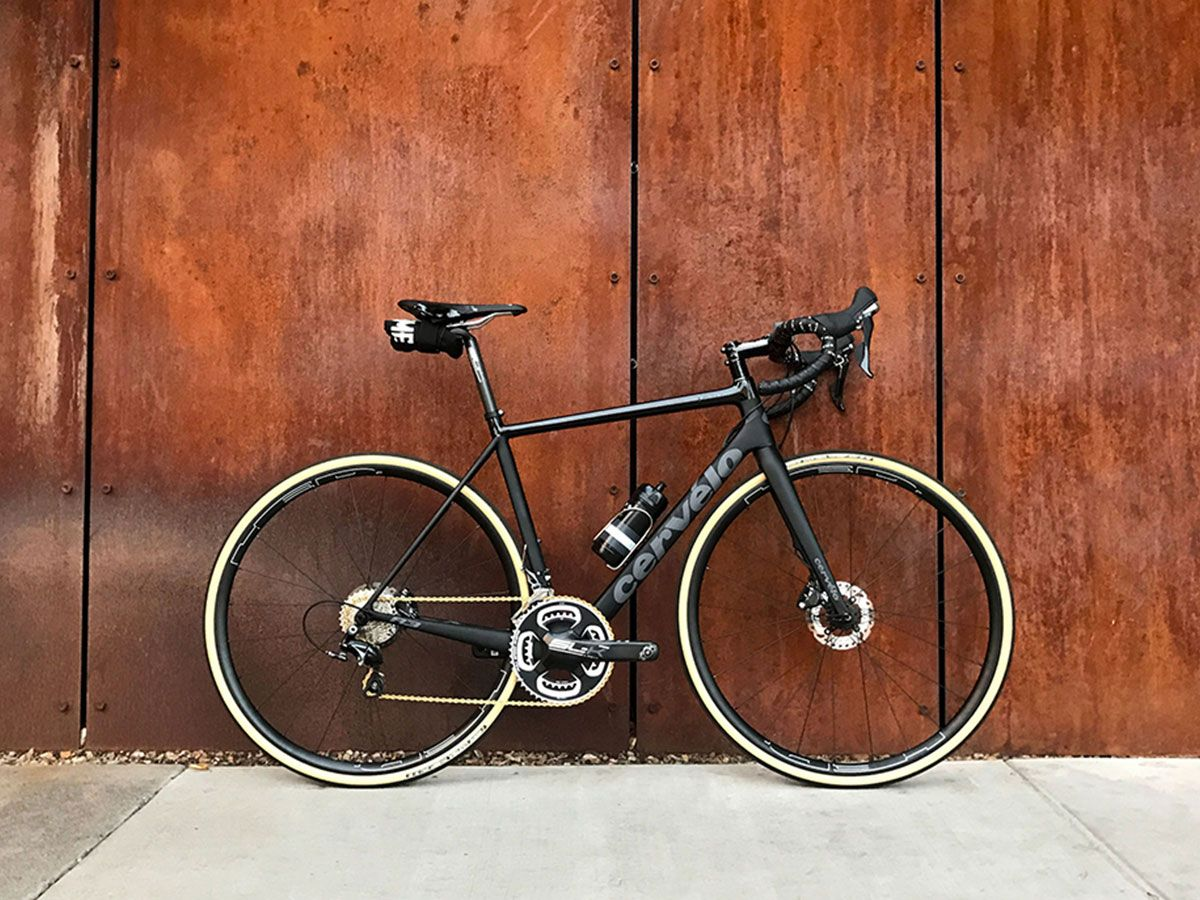 Road bike leaning against a wall