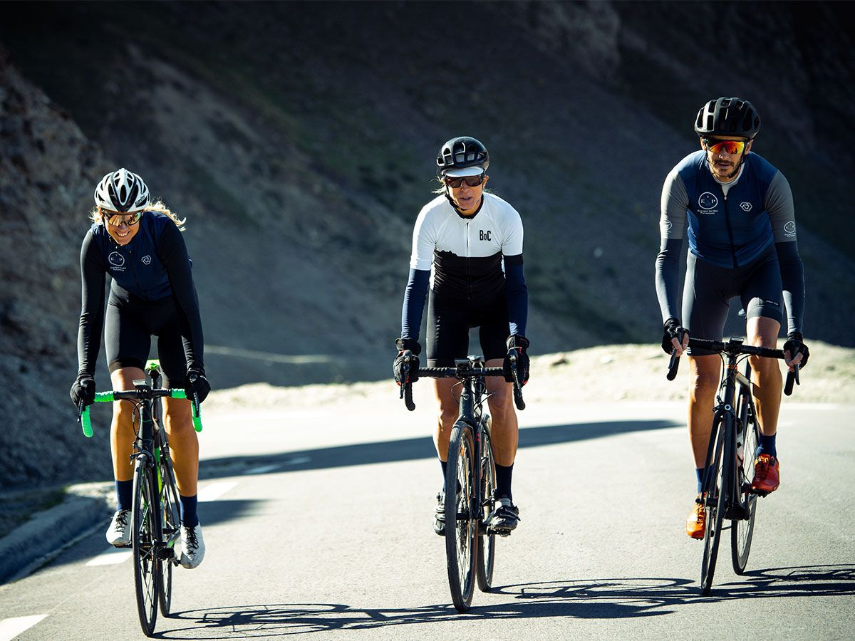 Group of cyclists climbing a mountain on road bikes