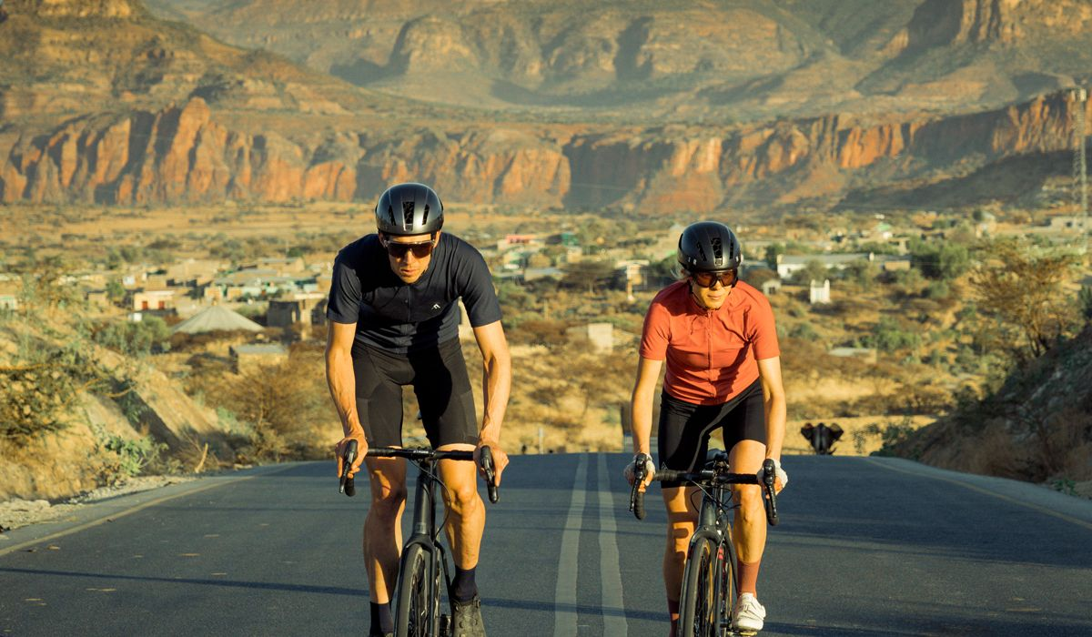 Male and female cyclist cycling in Ethiopia