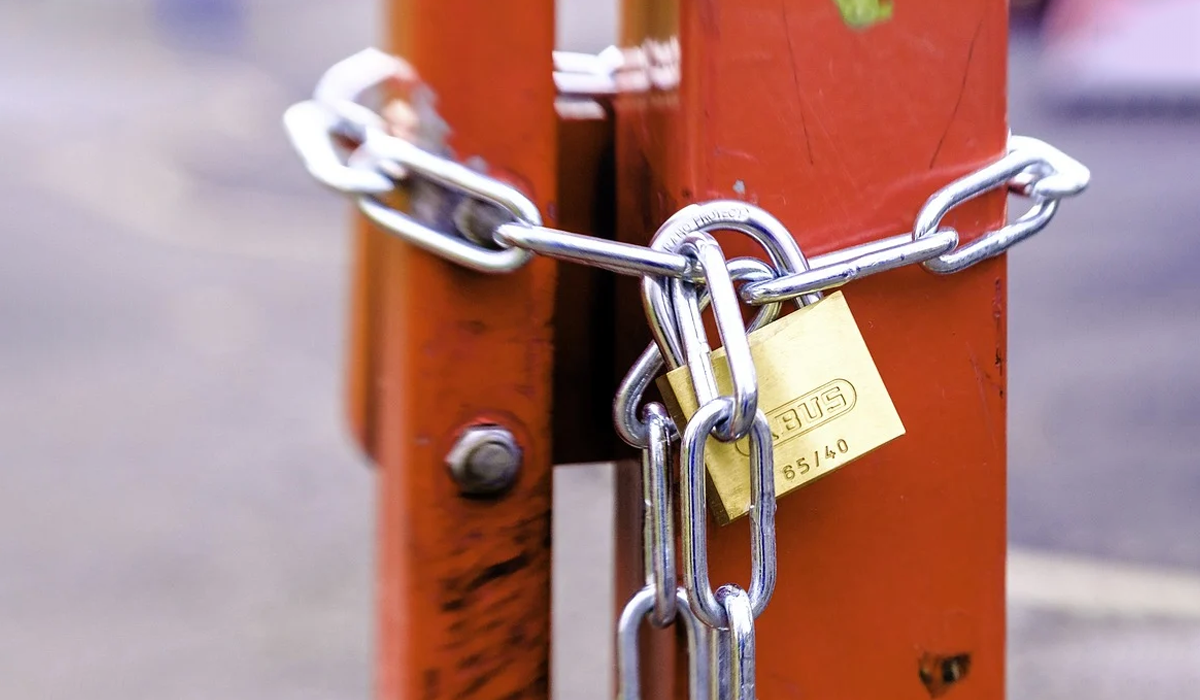 Lock chained to a gate