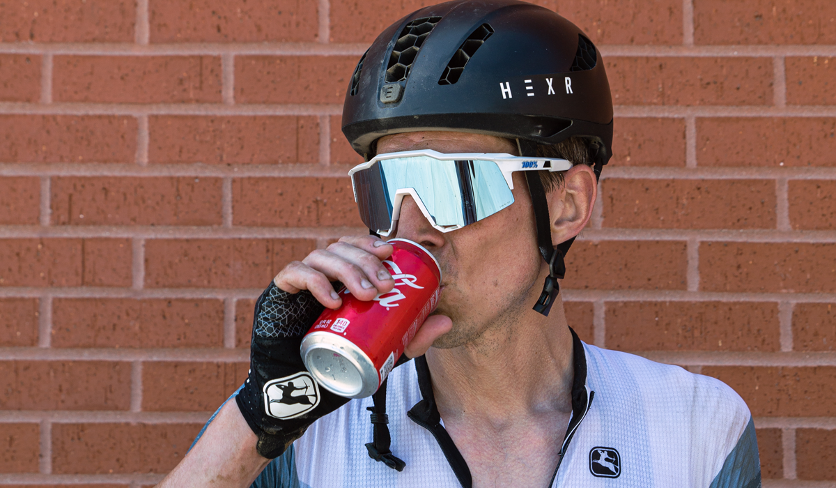 Cyclist drinking Coca Cola