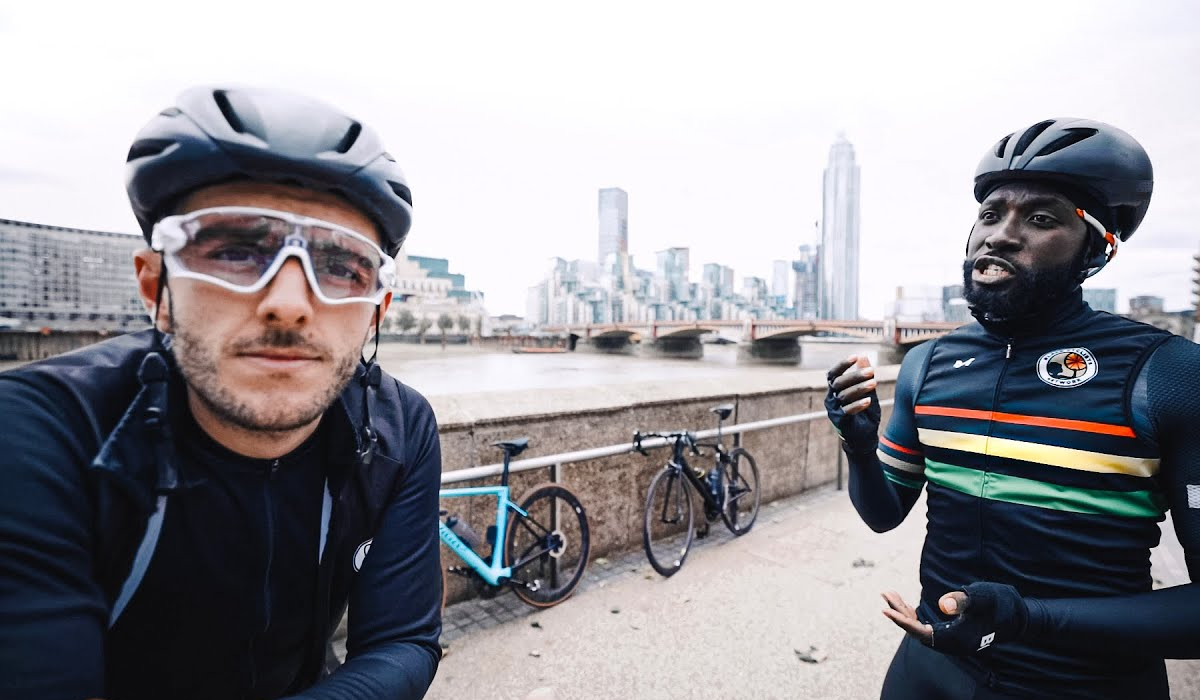 Two cyclists talking