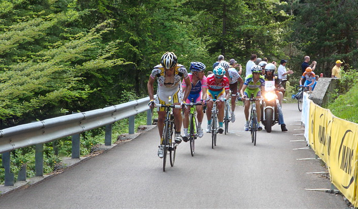 Pro cyclists riding the Zoncolan