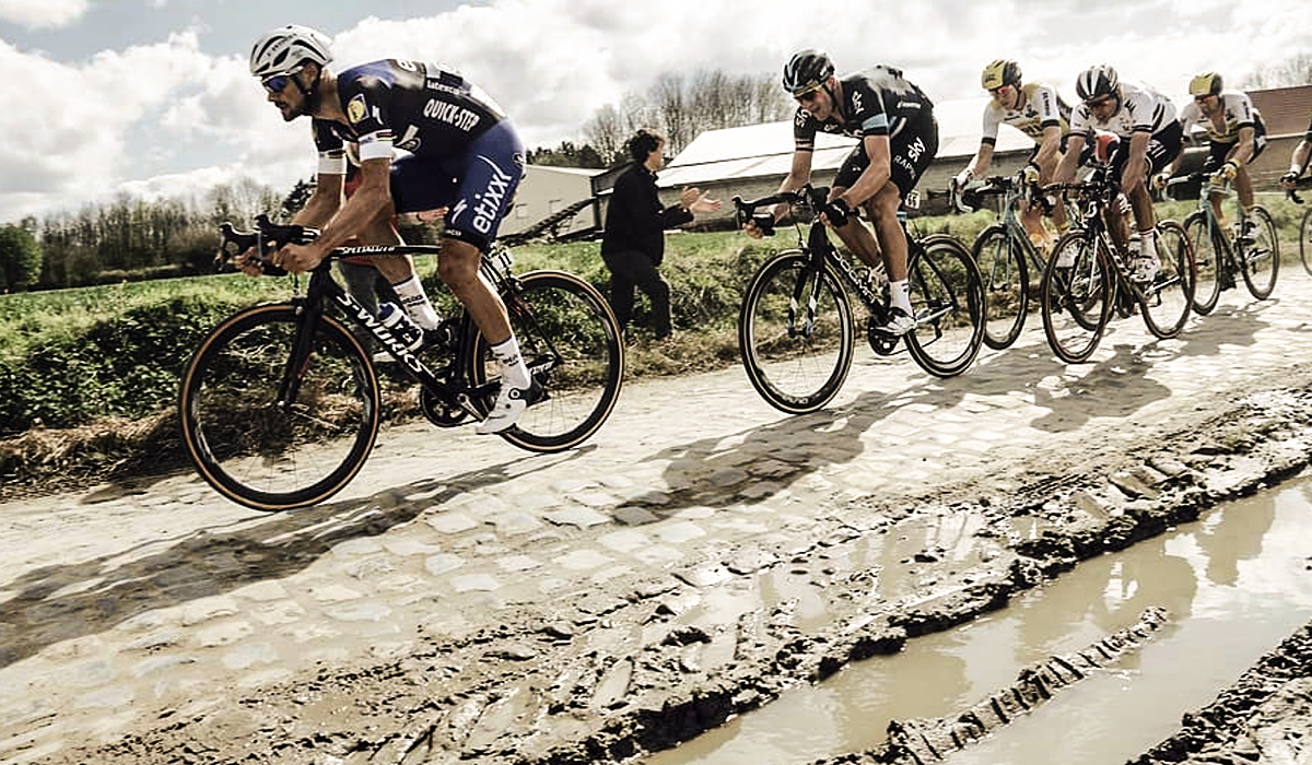Cyclists riding Paris Roubaix bike race