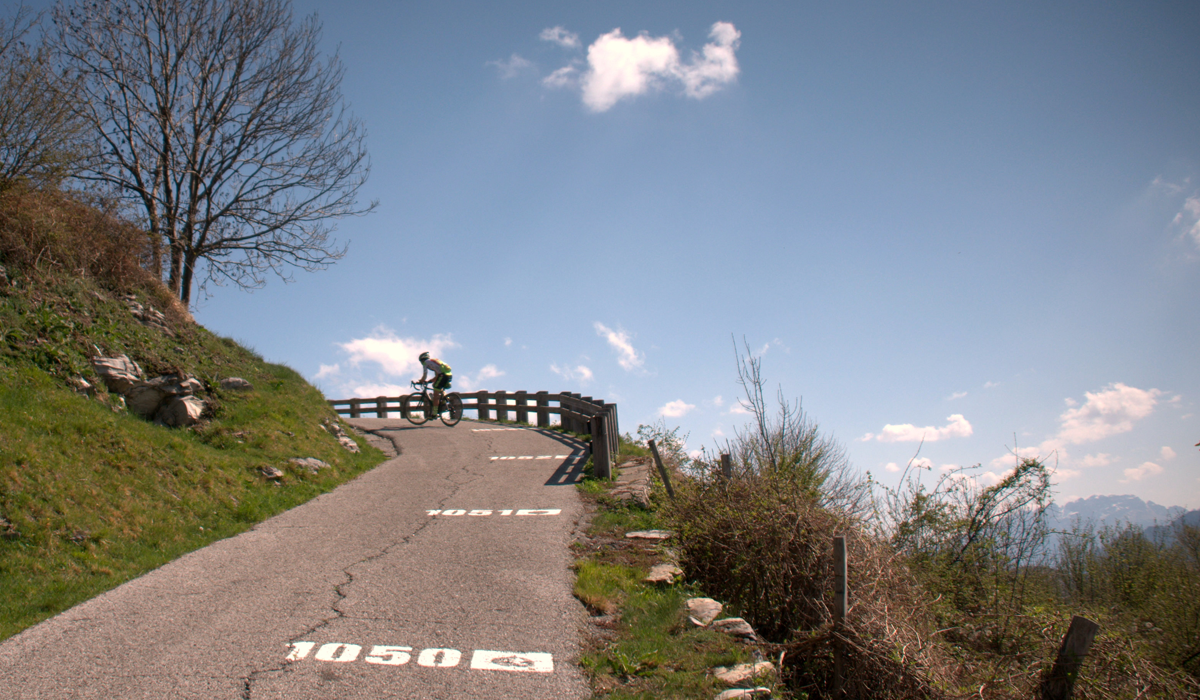 Cyclist riding up the Muro di Sormano