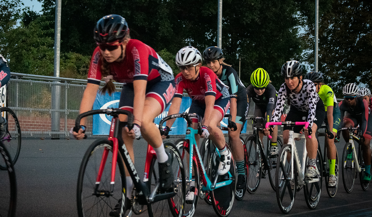 Women riding at velodrome