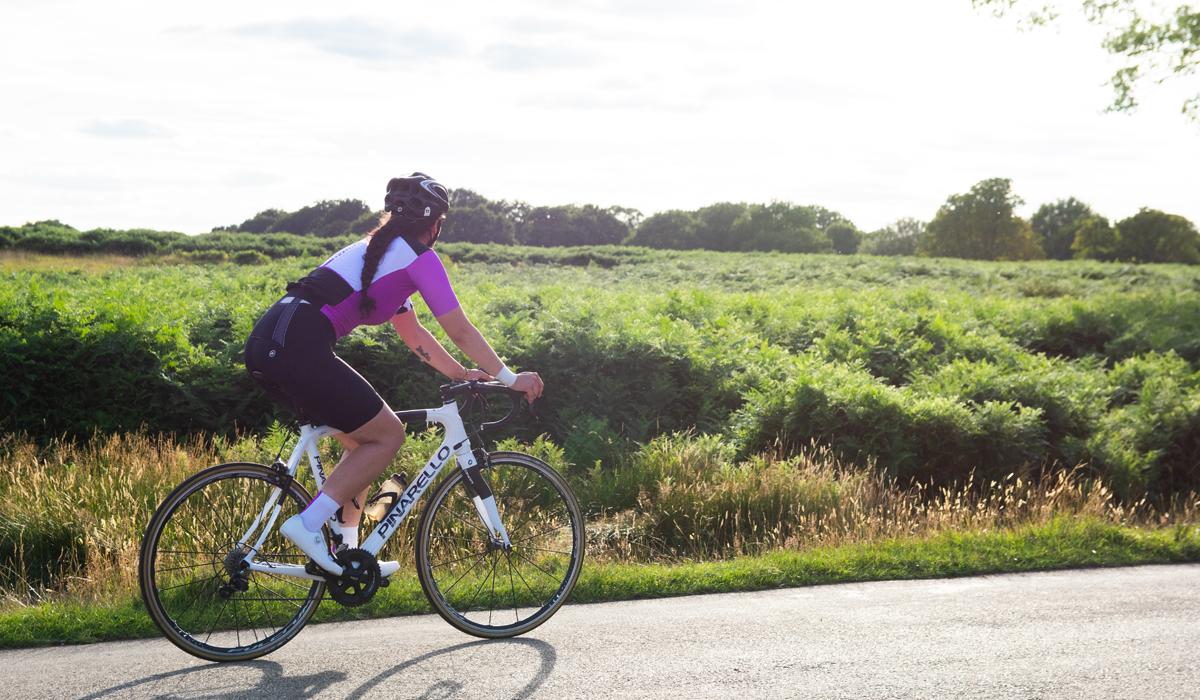 Woman cycling on Pinarello