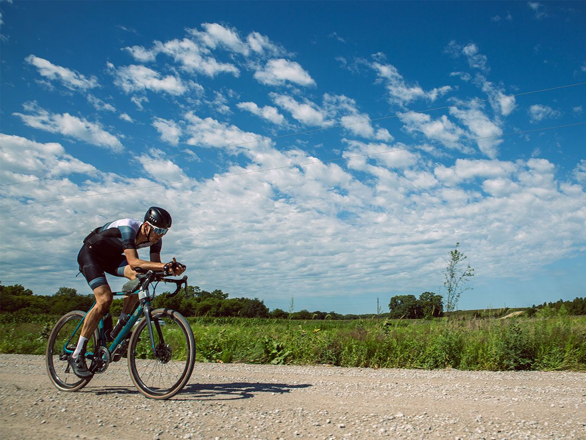 Cyclist riding on gravel at the Gravel Worlds