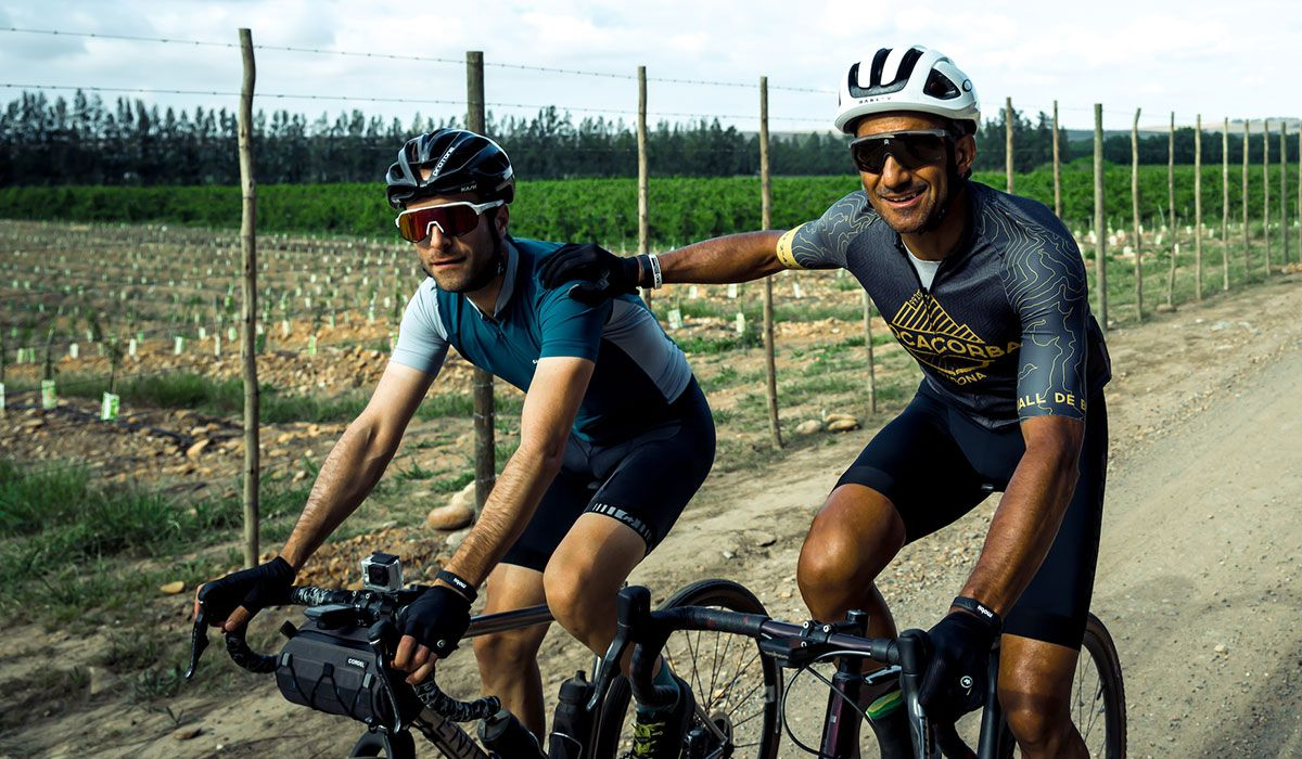 Two cyclists cycling in a group