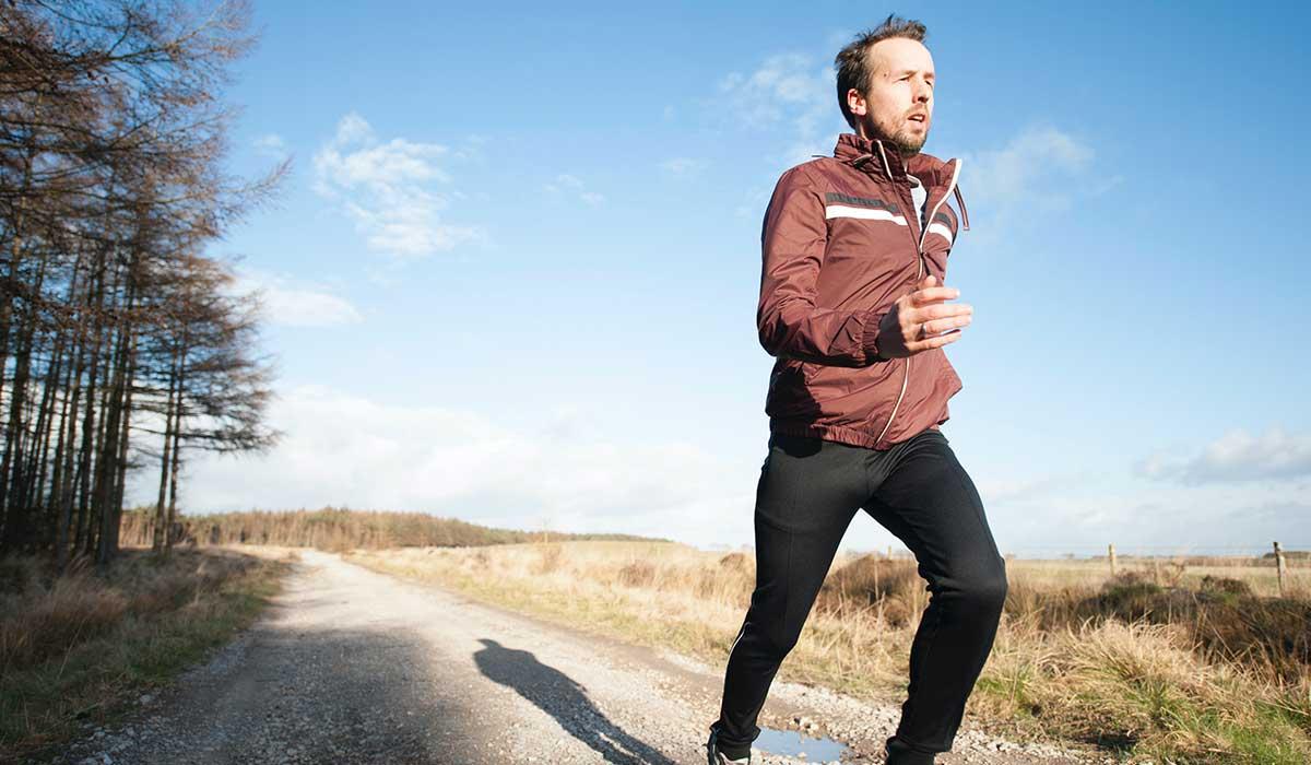 Runner running on gravel track