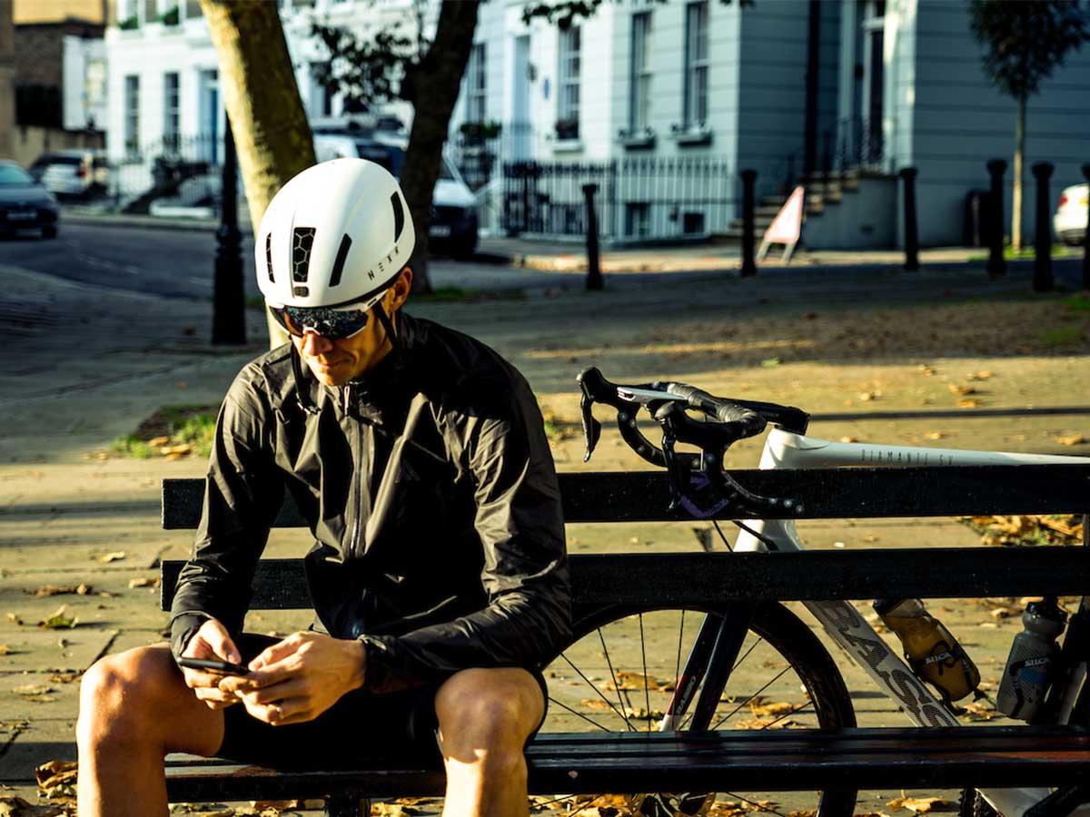Cyclist sitting on bench in lockdown